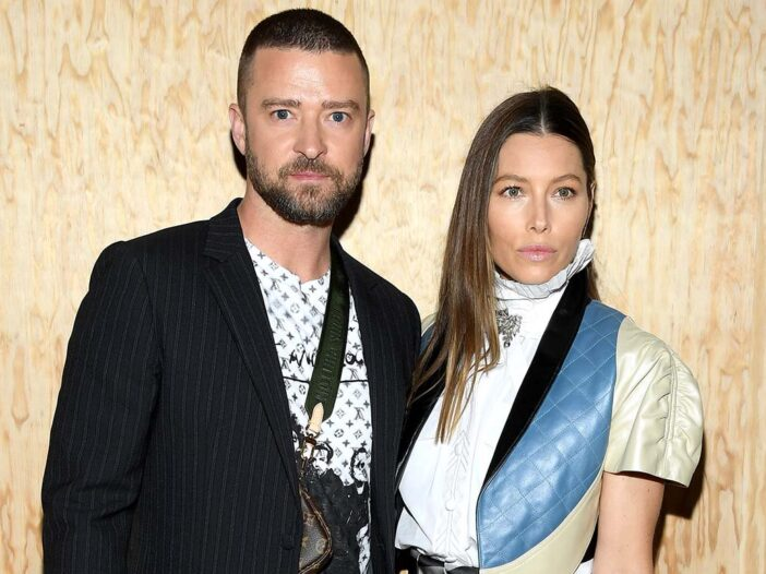 Justin Timberlake and Jessica Biel posing together at a red carpet event.