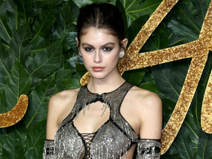 Kaia Gerber in a skimpy black and silver dress.