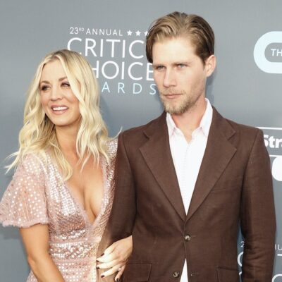 Kaley Cuoco in a sparkly dress smiling with husband Karl Cook in a suit