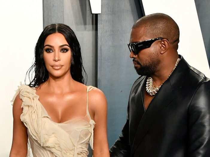 Kanye West on the roght, looking at Kim Kardashian on the left, who is looking straight forward.