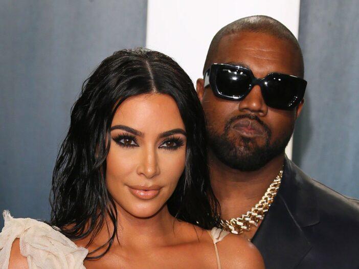 Kanye West standing closely behind Kim Kardashian
