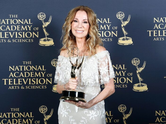 Kathie Lee Gifford holding an Emmy for her work on the Today Show