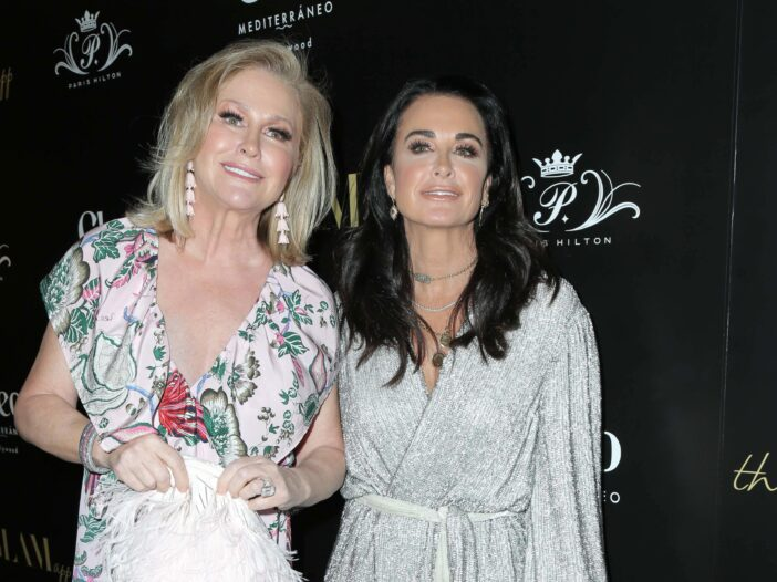 Kathy Hilton, left, stands with younger sister Kyle Richards, right, on the red carpet