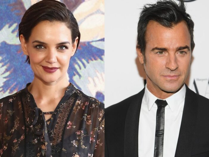 Katie Holmes in a dark blouse on the red carpet. Justin Theroux in a black suit on the red carpet