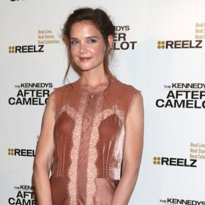 Katie Holmes in a sheer beige dress.