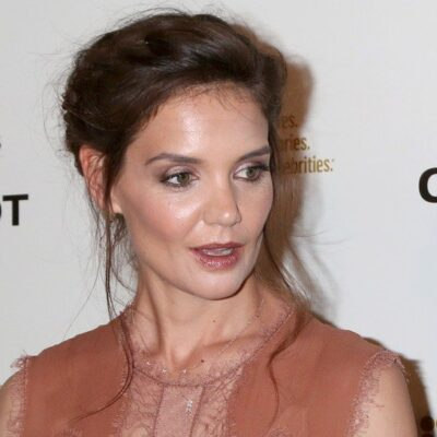 Katie Holmes wearing a brown, lacy dress attends a movie screening in 2015