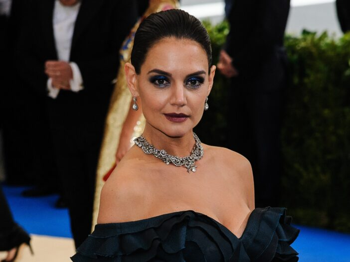Katie Holmes wearing dramatic dark make up and a dark blue ball gown at the Met Gala