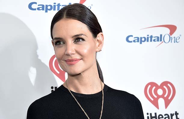 Katie Holmes with a pony tail, where a black shirt