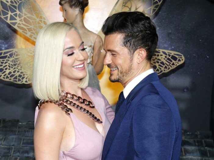 Katy Perry and Orlando Bloom hugging and smiling at each other at a premeire.