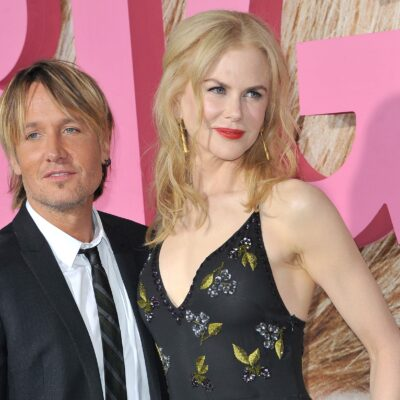 Keith Urban in a suit on the left, with Nicole Kidman in a black dress on the right.
