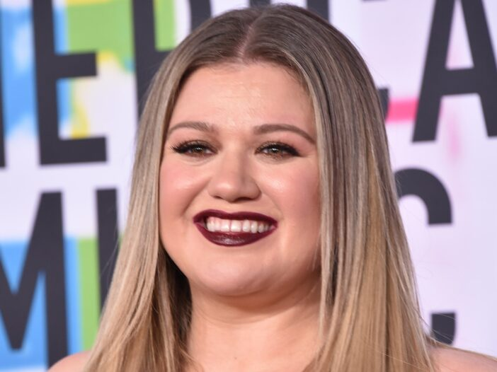 Kelly Clarkson wears an off the shoulder dress and dark lipstick on the red carpet