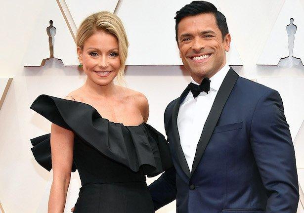 Kelly Ripa in a black dress and Mark Consuelos in a navy tuxedo
