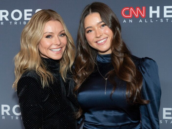 Kelly Ripa, wearing a black dress, attends the 13th Annual CNN Heroes her daughter, Lola Consuelos