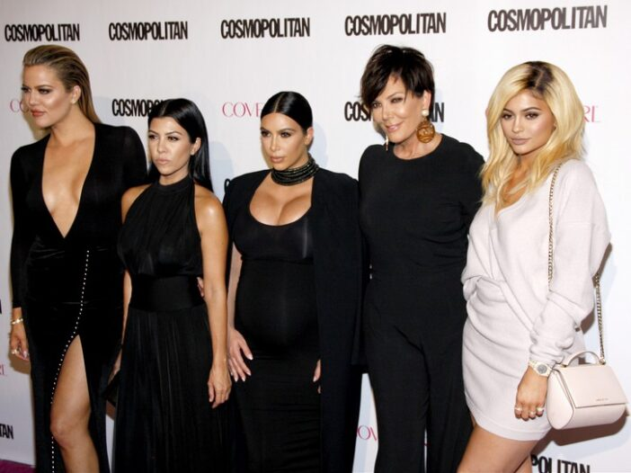 Khloe, Kourtney, and Kim Kardashian pose with Kris and Kylie Jenner at a clothing brand launch event
