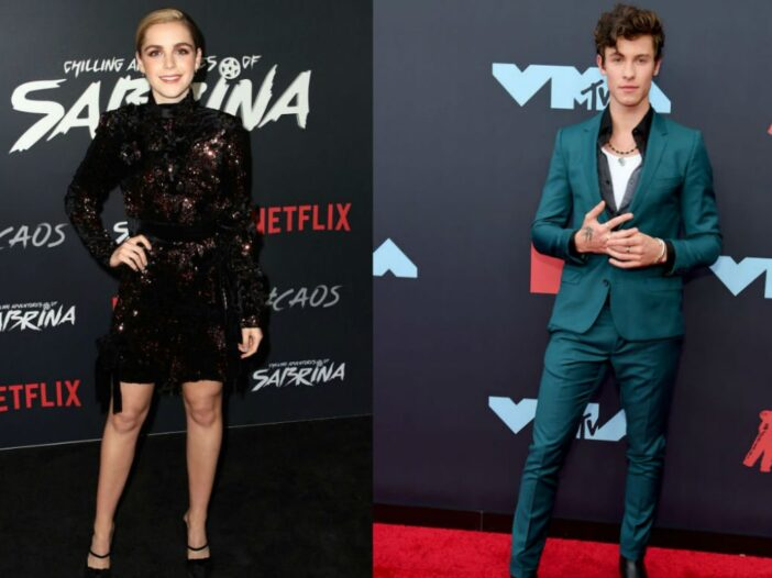 Kiernan Shipka in a black dress on the red carpet. Shawn Mendes in a teal suit on the red carpet.