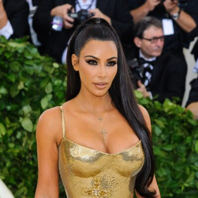 Kim Kardashian in a gold dress.