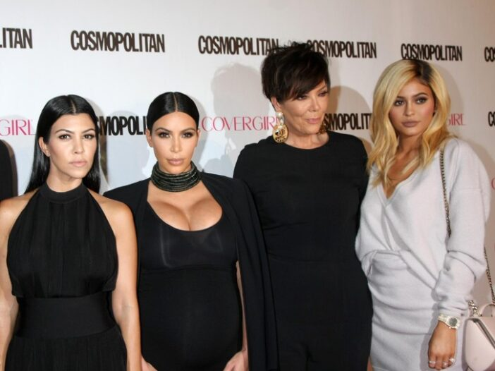 Kourtney, and Kim Kardashian with Kris and Kylie Jenner on the red carpet