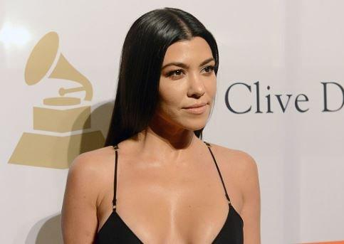 Kourtney Kardashian Pregnant HollywoodLife Flip-Flop