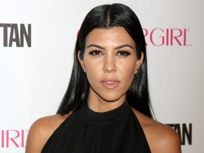Kourtney Kardashian wearing a black dress at the Cosmopolitan Magazine's 50th Anniversary Party