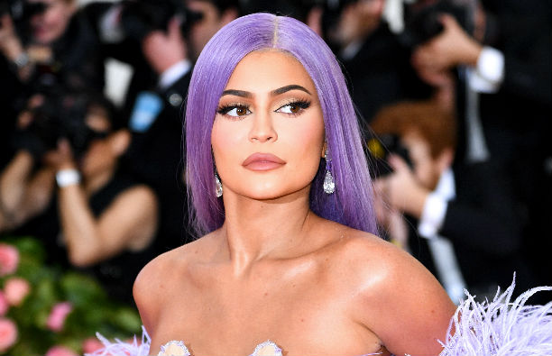 Kylie Jenner in a purple, feathered dress and purple wig at the Met Gala