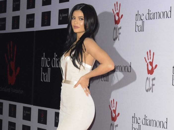 Kylie Jenner in a tight white dress.