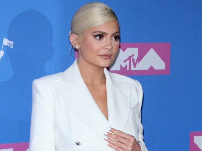 Kylie Jenner wearing a white dress to the MTV Music Awards in 2018