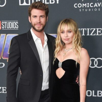 Liam Hemsworth and Miley Cyrus together at a movie premiere.