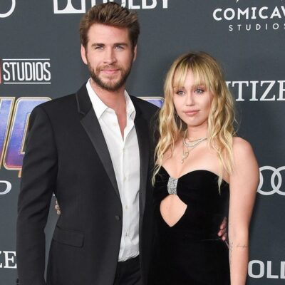 Liam Hemsworth in a suit on the left, with Miley Cyrus in a black dress on the right at the Avengers: Endgame premiere.