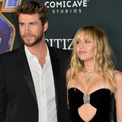 Liam Hemsworth (left) and Miley Cyrus at a movie premeire,