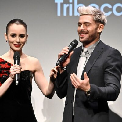 Lily Collins and Zac Efron on stage promoting their movie together.
