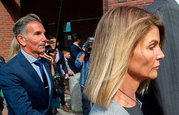 Lori Loughlin and her husband leaving a Boston courthouse