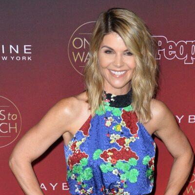 Lori Loughlin smiling in a multicolored dress