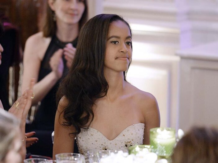 Malia Obama at a White House dinner wearing a white dress