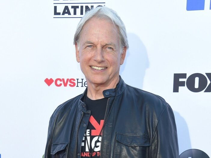 Mark Harmon smiling in a black leather jacket and shirt