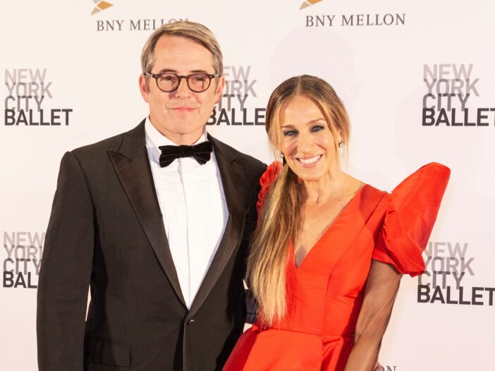 Matthew Broderick on the left in a tux, Sarah Jessica Parker on the right in a dramatic orange dress.