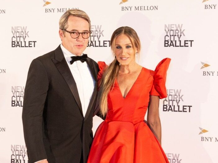 Matthew Broderick on the left in a tuxedo, Sarah Jessica Parker on the right in a red formal dress.