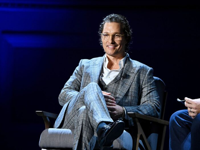 Matthew McConaughey sitting in a plaid suit