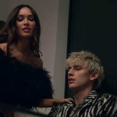 """Megan Fox in a black dress with Machine Gun Kelly in the music video for """"Bloody Valentine"""""""