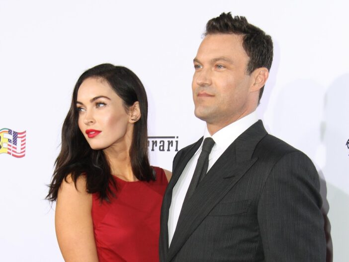 Megan Fox in a red dress smiling with ex husband Brian Austin Green in a grey suit
