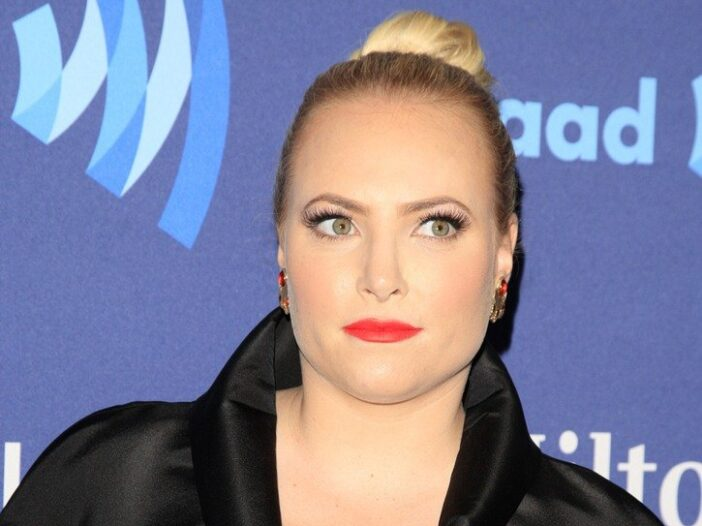 Meghan McCain wearing a black dress at a red carpet event