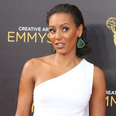 Mel B wearing a white dress on the red carpet at the Emmy Awards
