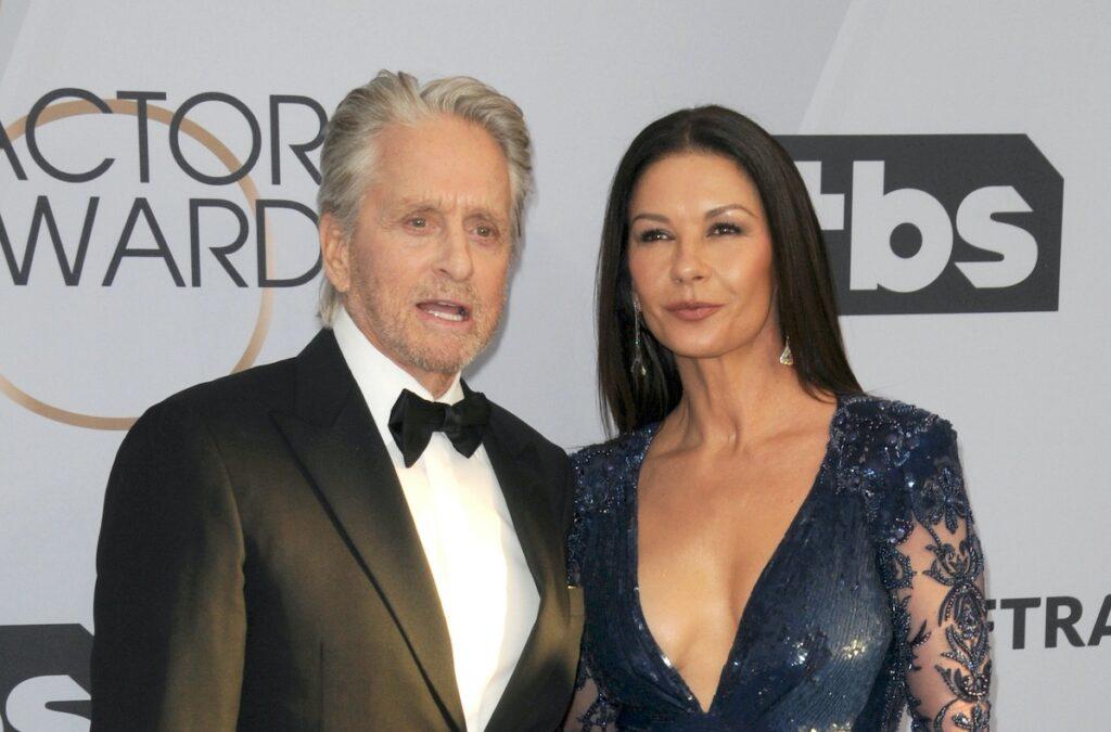 Michael Douglas in a tuxedo with wife Catherine Zeta-Jones