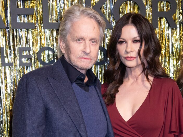 Michael Douglas on the left, looking dour in a suit, Catherine Zeta-Jones on the right, looking dour in a red dress.