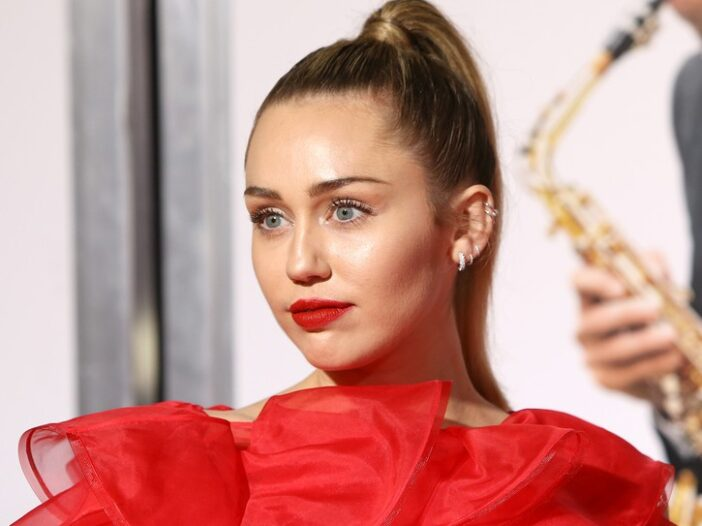Miley Cyrus in a red, puffy dress.