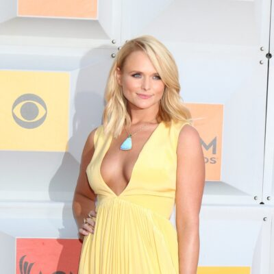 Miranda Lambert wearing a yellow dress with a plunging neckline at the Country Music Awards