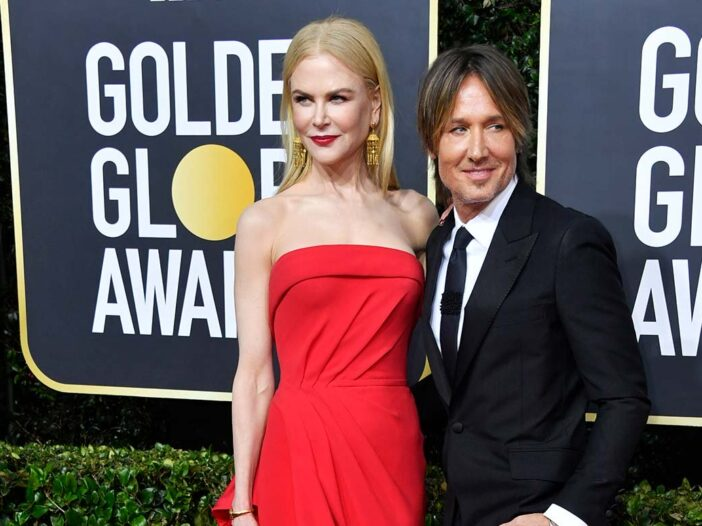 Nicole Kidman and Keith Urban smiling on the red carpet at the Golden Globes