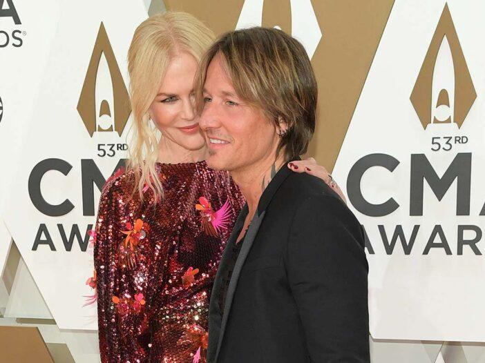 Nicole Kidman with her arm around Keith Urban at the CMA awards