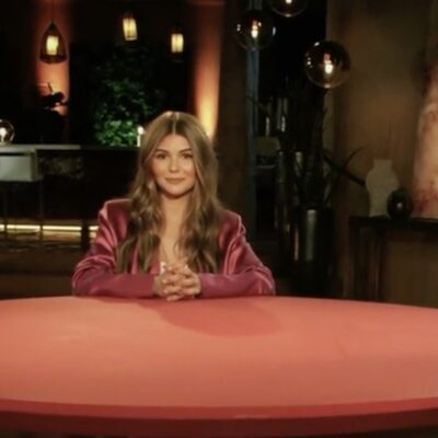 Olivia Jade Giannulli wears a dark pink suit on the set of Red Table Talk