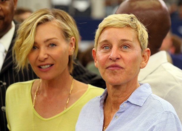 Portia de Rossi and Ellen DeGeneres watch the Green Bay Packers and Dallas Cowboys warm up before th