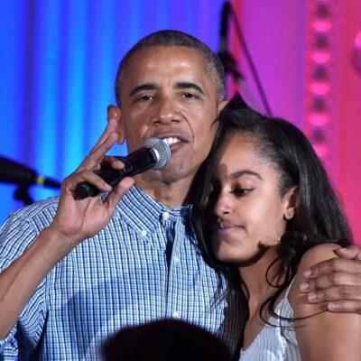 President Barack Obama hugging his daughter Malia